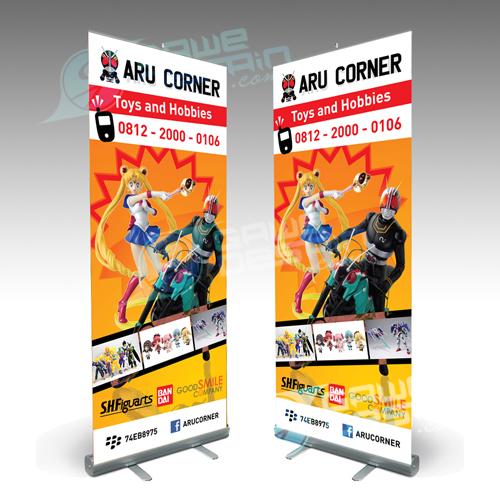 Roll Up Baner Aru Corner / Desain